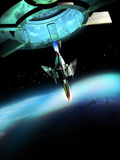 Spaceship and planet. Space fighter coming out from a mother-ship, and entering in the Earth atmosphere Stock Photo