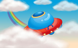 Spaceship and rainbow Stock Images