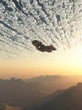 Spaceship under the Clouds. Science fiction illustration of a spaceship flying under the clouds of an earth-like planet at sunset, 3d digitally rendered Stock Photos