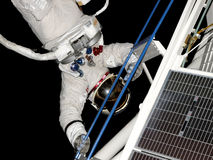Spacewalk_04. Astronaut working in the weightless vacuum of space Stock Images