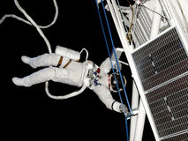 Spacewalk_05. Astronaut working in the weightless vacuum of space Stock Photography