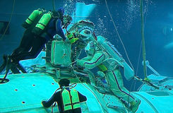 Spacewalk Training in the Hydrolab Pool. US astronaut Michael Barratt and Russian cosmonaut Gennady Padalka are training for spacewalks on the exterior of the Stock Photos