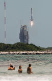 SpaceX Launch. SpaceX launched a dragon supply ship to the International Space Station from the Kennedy Space Centre. The first stage is landing back at Cape Stock Photo