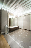 Spacious anteroom interior in warm tones and modern ceiling ligh Royalty Free Stock Photo