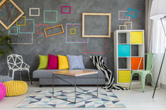 Spacious apartment in grey. With colorful wall decor and sofa Royalty Free Stock Photo