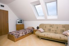 Spacious attic bedroom Royalty Free Stock Photos