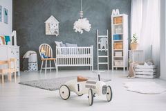 Spacious baby room with cot Stock Photography