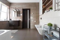 Spacious bathroom in brown tones Royalty Free Stock Photos