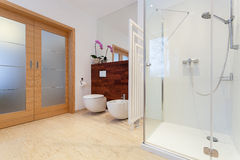 Spacious bathroom with doors Royalty Free Stock Images