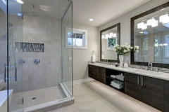 Spacious bathroom in gray tones with heated floors Royalty Free Stock Photography