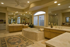 Spacious Bathroom In House. View of a spacious and luxury bathroom in a house Royalty Free Stock Photography