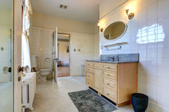 Spacious bathroom interior with vanity cabinet Royalty Free Stock Photos