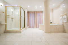Spacious bathroom in luxury mansion Royalty Free Stock Photos