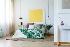 Spacious bedroom with artworks Royalty Free Stock Photography