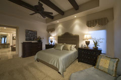 Spacious Bedroom With Beamed Ceiling At Home Royalty Free Stock Photography