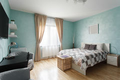 Spacious bedroom in blue color Stock Photography
