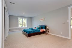 Spacious bedroom with built in closets. In front of a blue bed royalty free stock photo