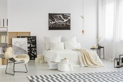 Spacious bedroom with map poster Royalty Free Stock Image