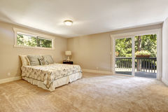 Spacious bedroom interior with walkout deck Royalty Free Stock Photo