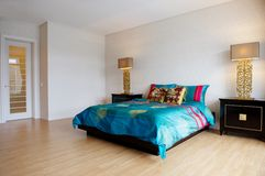 Spacious bedroom with modern furniture royalty free stock photography