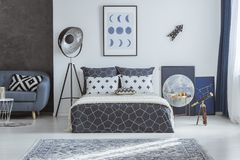Spacious blue bedroom with telescope Royalty Free Stock Photography