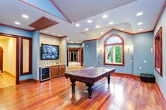 Spacious blue entertainment room in a wedding venue. Spacious blue entertainment room filled with Billiard Pool Table and wet bar royalty free stock photography