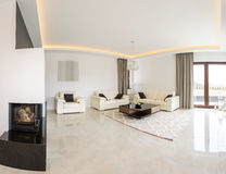 Spacious bright room. Spacious bright living room with fireplace and marble floor Royalty Free Stock Images