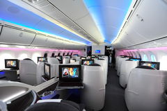 Spacious business class cabin of Qatar Airways Boeing 787-8 Dreamliner at Singapore Airshow royalty free stock images