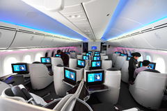 Spacious business class cabin of Qatar Airways Boeing 787-8 Dreamliner at Singapore Airshow. SINGAPORE - FEBRUARY 12: Spacious business class cabin of Qatar Royalty Free Stock Image