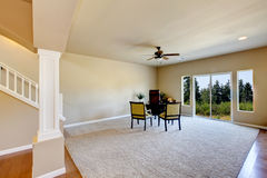Spacious carpet floor home office interior. Royalty Free Stock Images