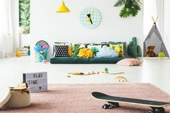 Spacious colorful child`s playroom stock photos