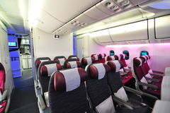 Spacious and comfortable economy class cabin of Qatar Airways Boeing 787-8 Dreamliner at Singapore Airshow Stock Image