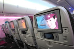 Spacious and comfortable economy class cabin of Qatar Airways Boeing 787-8 Dreamliner at Singapore Airshow Royalty Free Stock Image