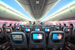 Spacious and comfortable economy class cabin of Qatar Airways Boeing 787-8 Dreamliner at Singapore Airshow Stock Images