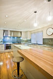 Spacious contemporary kitchen Stock Images