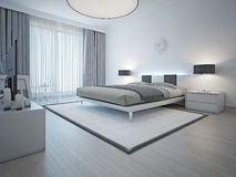 Spacious contemporary styled bedroom Royalty Free Stock Image