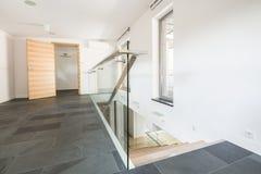 Spacious corridor with gray floor Royalty Free Stock Photography
