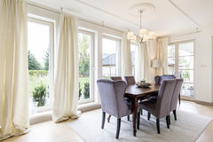 Spacious dining room in white tones Stock Image