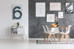 Free Spacious Dining Room With Posters Stock Image - 98202021