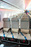 Spacious economy class of a Boeing 787 Dreamliner with dynamic LED lighting at Singapore Airshow 2012 Royalty Free Stock Images