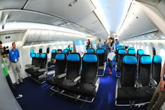 Spacious economy class of a Boeing 787 Dreamliner with dynamic LED lighting at Singapore Airshow 2012 Stock Image