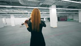 Spacious empty hall with a woman playing the violin. 4K stock video footage