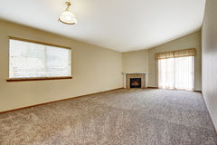 Spacious empty living room with fireplace Royalty Free Stock Photo
