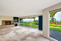 Spacious empty living room with walkout basement overlooking bea Stock Photography