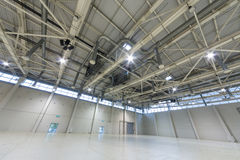 Spacious empty pavilion MosExpo with gates for a car and doors for a people Royalty Free Stock Images