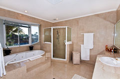 Spacious Ensuite Bathroom. A modern and spacious ensuite bathroom in a waterfront home Stock Images