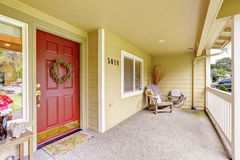 Spacious entrance porch with red door Royalty Free Stock Photography