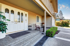 Spacious entrance porch with white Double front doors of luxury home. royalty free stock image