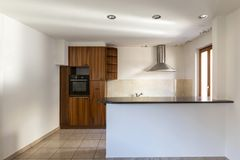 Spacious and equipped kitchen in a house stock photos