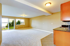 Spacious family room with kitchen cabinets. Royalty Free Stock Image